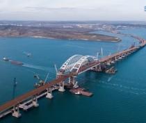 Дорожники форсируют подходы к мосту